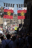 Pedestrians pass along the Royal Mile beneath heraldic flags in Edinburgh UK on Tuesday July 30 2013 The latest opinion polls show supporters of...