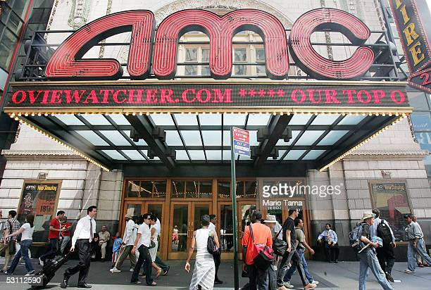 Pedestrians pass an AMC movie theater in Times Square June 21 2005 in New York City AMC Entertainment Inc announced plans to acquire Loews Cineplex...