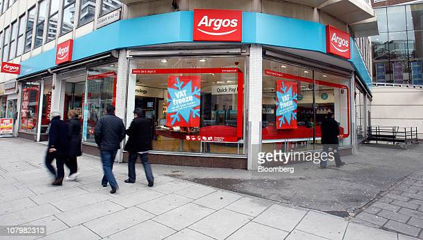 Pedestrians pass an Argos store operated by Home Retail Group Plc in London UK on Tuesday Jan 11 2011 UK retail sales fell last month as snow and the...