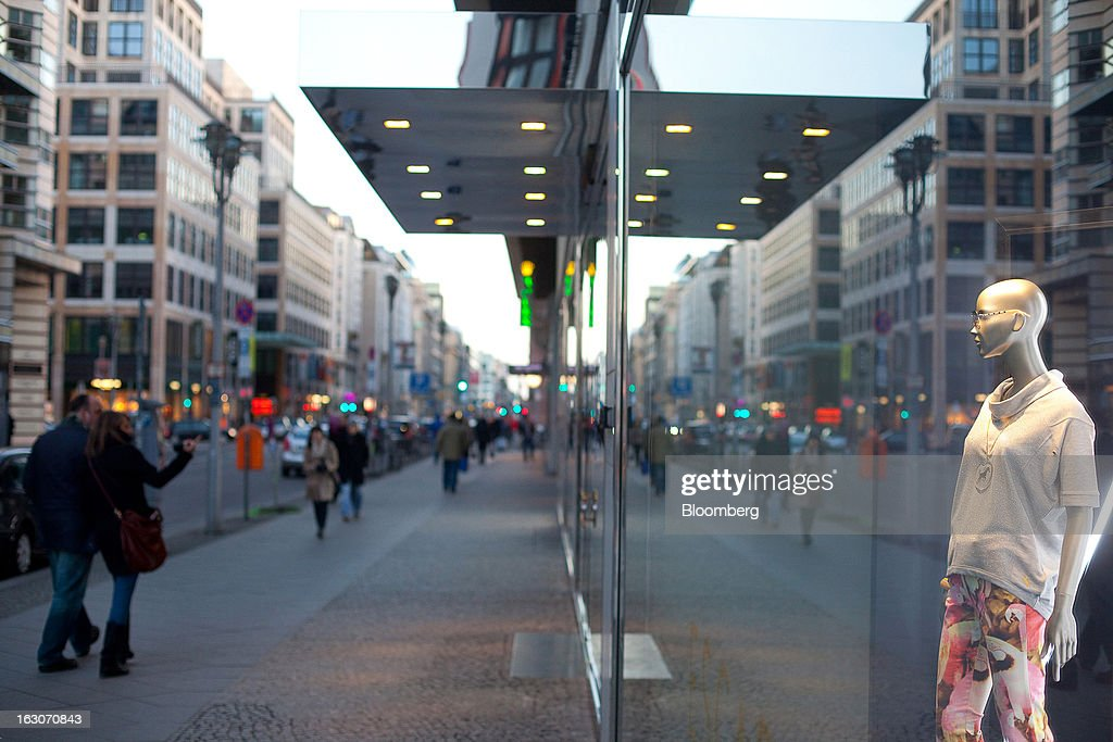 Pedestrians pass an Escada store on Friedrichstrasse in the Mitte district of Berlin, Germany, on Sunday, March 3, 2013. Germany's 10-year government bonds advanced for a second day even before a report that economists said will show producer prices in the euro area increased for the first time in four months in January. Photographer: Krisztian Bocsi/Bloomberg via Getty Images
