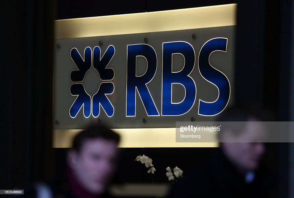 Pedestrians pass an office of Royal Bank of Scotland Group Plc (RBS), in London, U.K., on Friday, Feb. 22, 2013. RBS, Britain's biggest publicly owned lender, was fined $612 million by regulators in the U.K. and the U.S. for rigging the London interbank offered rate and similar benchmarks. Photographer: Chris Ratcliffe/Bloomberg via Getty Images