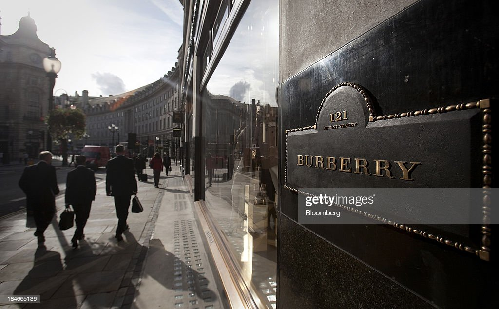 Pedestrians pass Burberry Group Plc's new flagship luxury clothing store in London, U.K., on Monday, Sept. 17, 2012. Burberry Group said Christopher Bailey will become chief executive officer of the largest British luxury-goods producer, as CEO Angela Ahrendts departs the company to work at Apple Inc. Photographer: Simon Dawson/Bloomberg via Getty Images