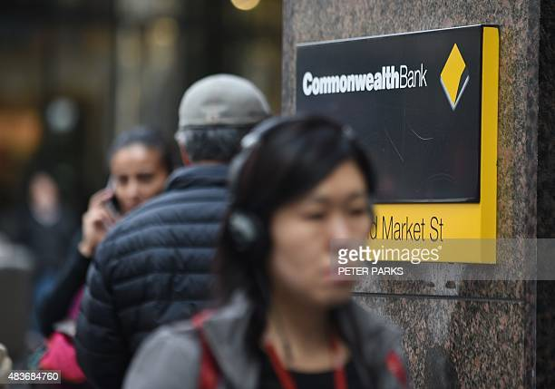 Pedestrians pass by a branch of Australia's biggest bank the Commonwealth in Sydney on August 12 2015 The Commonwealth Bank the nation's largest...