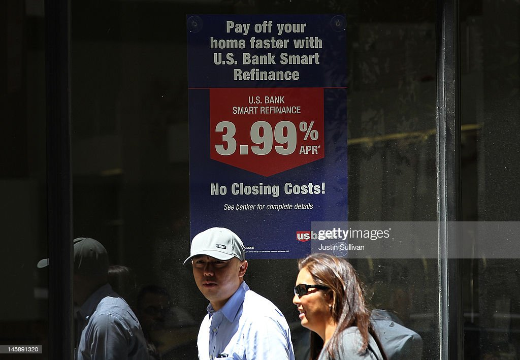 Pedestrians pass by a sign advertising low refinance rates at a US Bank office on June 7, 2012 in San Francisco, California. Average rates for 30 and 15 year fixed mortgages fell for the sixth straight week to record lows. The 30 year loan fell to 3.67 percent from 3.75 percent last week and the 15 year mortgage dropped to 2.94 percent compared 2.97 percent one week ago.