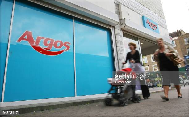 Pedestrians pass by an Argos shop owned by Home Retail Group plc in London UK on Wednesday June 18 2008 European confidence dropped more than...