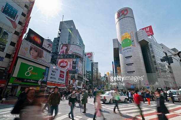 Pedestrians pass by Shibuya 109 a fashion complex for young women and an icon of the Shibuya district on March 13 2013 in Tokyo Japan Tokyu Toyoko...