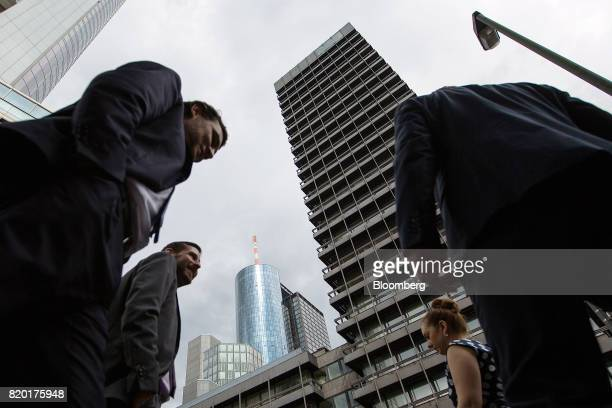 Pedestrians pass by skyscrapers in Frankfurt Germany on Thursday July 20 2017 Frankfurt has emerged as a winner of the Brexit vote with Standard...
