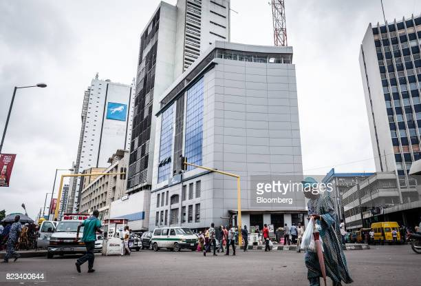 Pedestrians pass city office buildings in Lagos Nigeria on Wednesday July 26 2017 Nigeria's economy which in 2016 suffered its first fullyear...