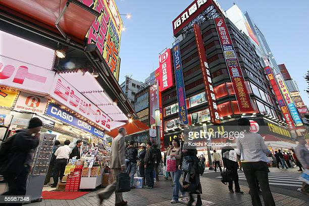 Pedestrians pass electronics shops on the Akihabara electricity street in the Akihabara District October 23 2005 in Tokyo Japan The Akihabara...