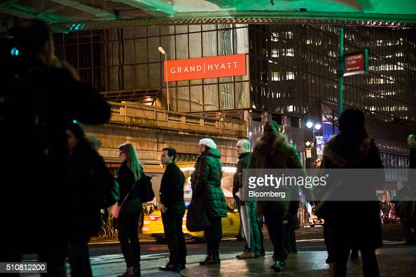 Pedestrians pass Hyatt Hotels Corp's Grand Hyatt at Grand Central Station in New York US on Tuesday Feb 16 2016 Hyatt Hotels Corp is scheduled to...