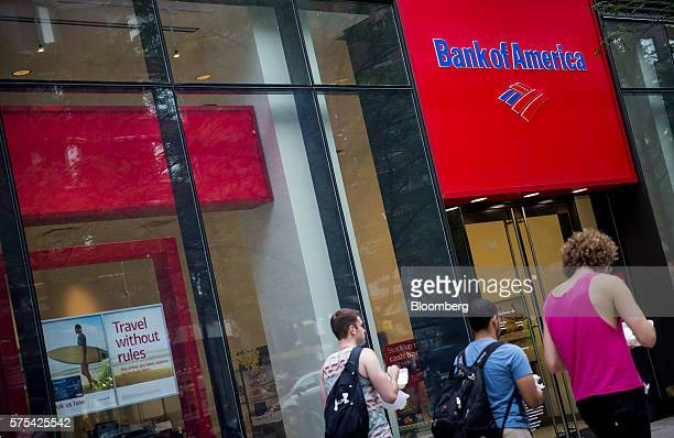 Pedestrians pass in front of a Bank of America Corp branch in New York US on Wednesday July 13 2016 Bank of America Corp is scheduled to release...