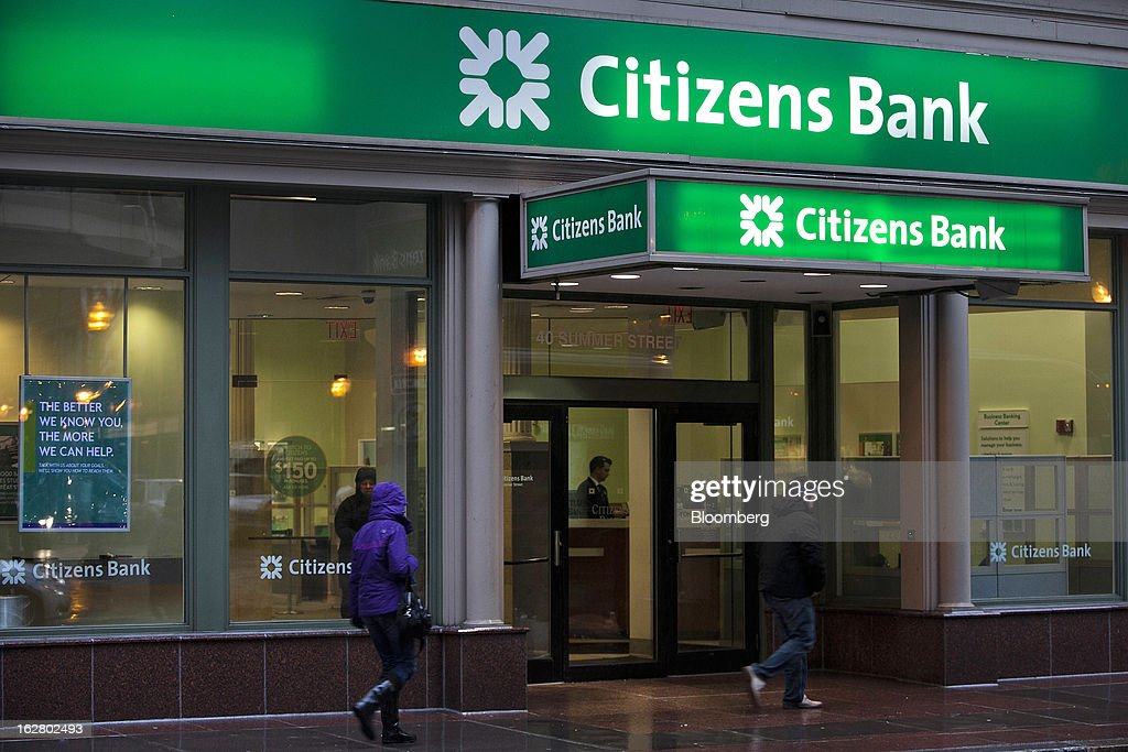 Pedestrians pass in front of a Citizens Financial Group Inc. bank branch in Boston, Massachusetts, U.S., on Wednesday, Feb. 27, 2013. Royal Bank of Scotland Group Plc will this week announce plans to sell a stake in Citizens Financial Group Inc. and shrink assets at its investment-bank by as much as 30 billion pounds, said a person with knowledge of the plans, who asked not to be identified because the matter is private. Photographer: Kelvin Ma/Bloomberg via Getty Images