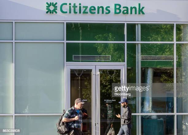 Pedestrians pass in front of a Citizens Financial Group Inc bank branch in downtown Boston Massachusetts US on Tuesday Oct 10 2017 Citizens Financial...