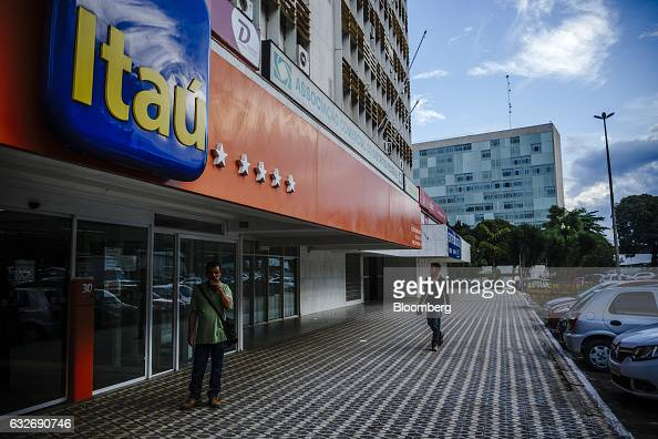 Pedestrians pass in front of a Itau Unibanco Holding SA bank branch in Brasilia Brazil on Friday Jan 20 2017 Itau the biggest bank in Latin America...