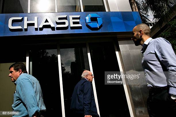 Pedestrians pass in front of a JPMorgan Chase Co bank branch in Miami Florida US on on Thursday Jan 5 2017 JPMorgan Chase Co is scheduled to release...