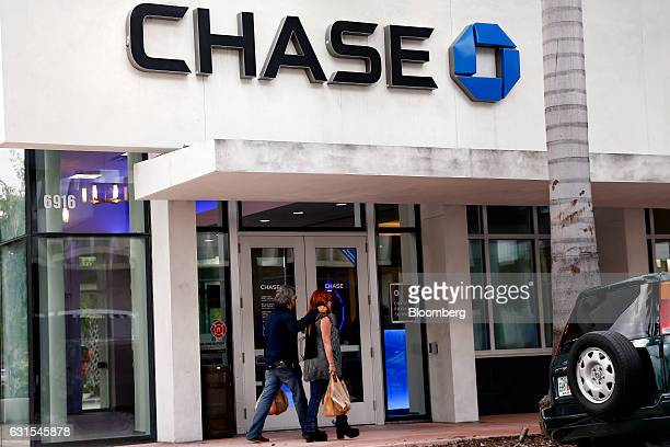 Pedestrians pass in front of a JPMorgan Chase Co bank branch in Miami Beach Florida US on Wednesday Jan 11 2017 JPMorgan Chase Co is scheduled to...