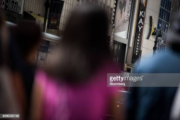 Pedestrians pass in front of a Kay Jewelers store a subsidiary of Signet Jewelers Ltd in New York US on Wednesday Aug 23 2017 Signet Jewelers Ltd is...