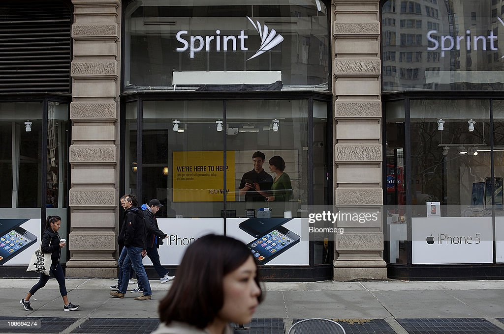 Pedestrians pass in front of a Sprint Nextel Corp. store in New York, U.S., on Monday, April 15, 2013. Dish Network Corp., the satellite-TV company controlled by Charlie Ergen, made an unsolicited $25.5 billion offer for Sprint Nextel Corp., topping a Softbank Corp. bid for the third-largest U.S. wireless carrier. Photographer: Victor J. Blue/Bloomberg via Getty Images