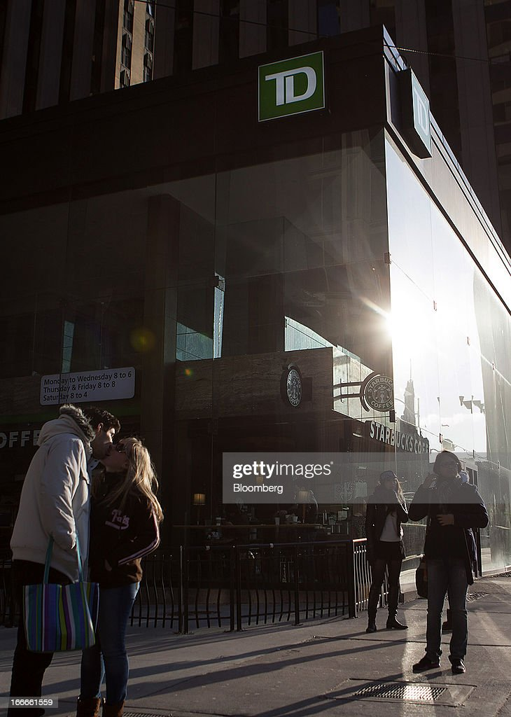 Pedestrians pass in front of a Toronto-Dominion Bank branch in Toronto, Ontario, Canada, on Sunday, April 14, 2013. The Canadian dollar fluctuated against its U.S. counterpart amid speculation the economy is slowing after an unexpected jobs loss last month. Photographer: Pawel Dwulit/Bloomberg via Getty Images