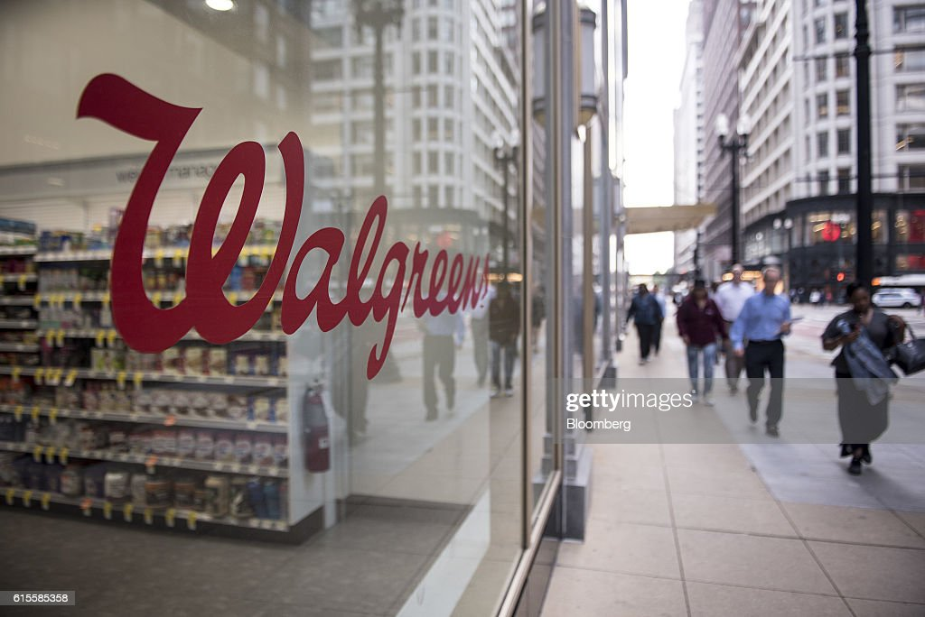 Pedestrians pass in front of a Walgreens Boots Alliance Inc  store in  downtown Chicago. Inside A Walgreens Boots Alliance Location Ahead Of Earnings