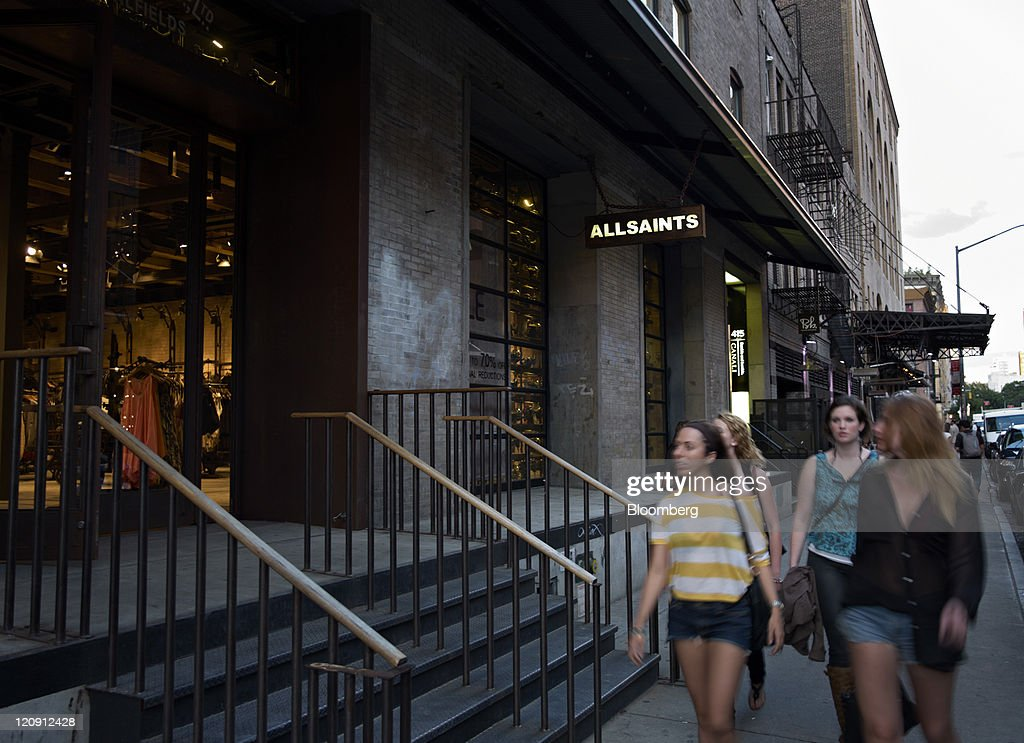 Pedestrians pass in front of an AllSaints store in the Meatpacking District of New York, U.S., on Thursday, Aug. 11, 2011. Stores such as Kalinsky's Jeffrey New York transformed the Meatpacking District of slaughterhouses and packing plants into an area known for chic restaurants and trendy shops and clubs. Now its popularity is driving up rents. Photographer: Guy Calaf/Bloomberg via Getty Images