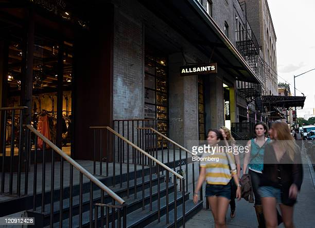 Pedestrians pass in front of an AllSaints store in the Meatpacking District of New York US on Thursday Aug 11 2011 Stores such as Kalinsky's Jeffrey...