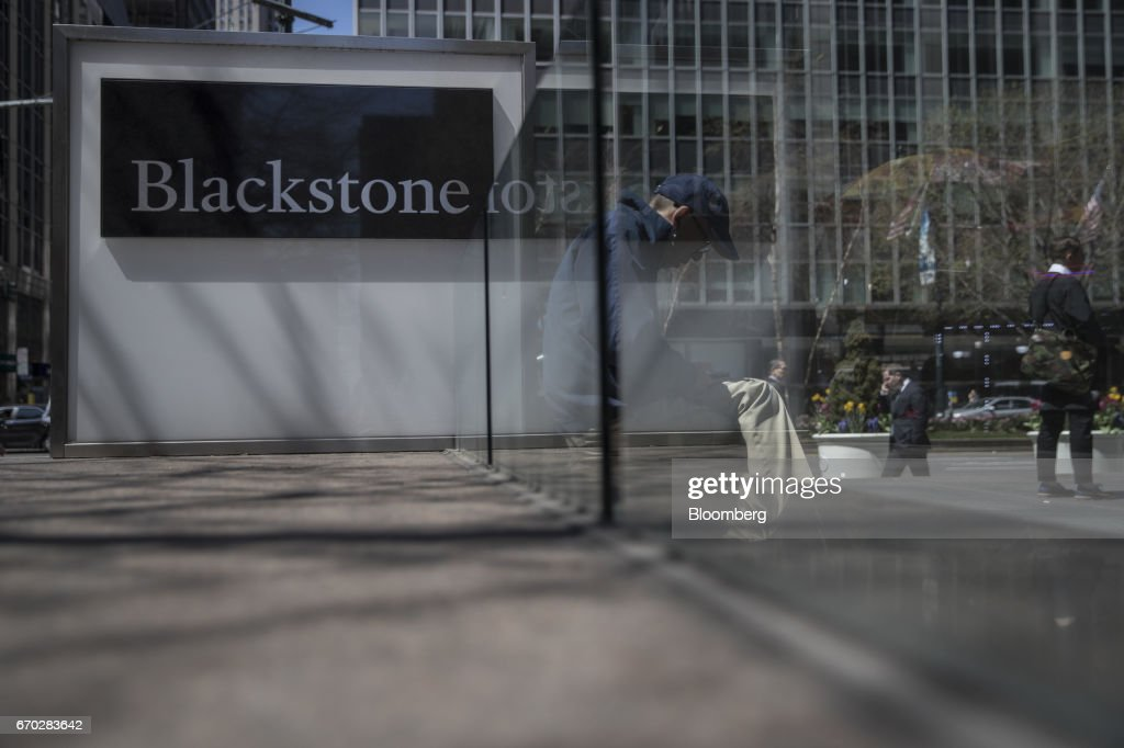 Pedestrians pass in front of Blackstone Group LP headquarters in New York, U.S., on Friday, April 14, 2017. Blackstone Group LP is scheduled to release earnings figures on April 20. Photograph: Victor J. Blue/Bloomberg via Getty Images