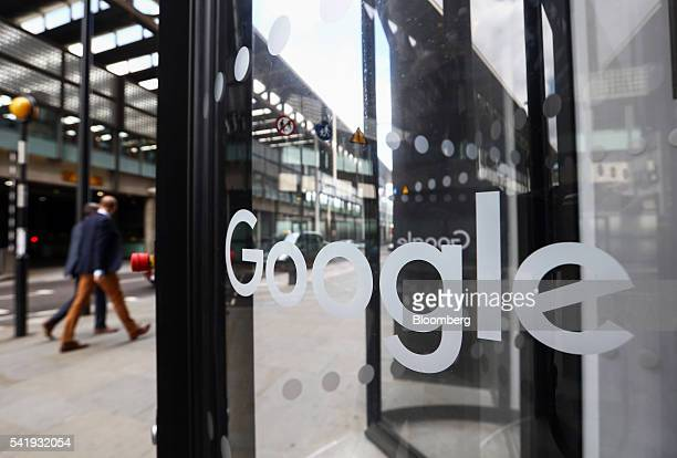 Pedestrians pass in front of Google Inc's new UK headquarters at Six St Pancras Square in London UK on Tuesday June 21 2016 The owner of the world's...