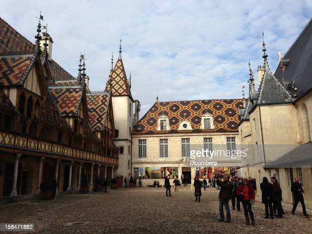 Pedestrians pass in front of Hospices des Beaune in Beaune France on Sunday Nov 18 2012 Since 1851 the Burgundian wine trade attends a charity...