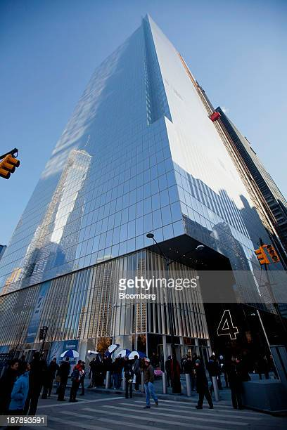 Pedestrians pass in front of the 4 World Trade Center building during a dedication ceremony in New York US on Monday Nov 4 2013 4 World Trade Center...