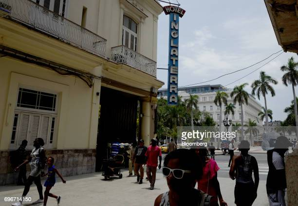 Pedestrians pass in front of the Inglaterra Hotel in Havana Cuba on Friday June 16 2017 US President Donald Trump announced new restrictions Friday...