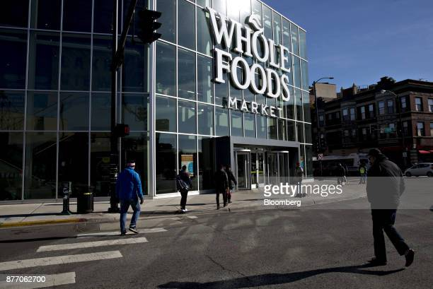 Pedestrians pass in front of the Lakeview Whole Foods Market Inc store in Chicago Illinois US on Monday Nov 20 2017 Amazoncom Inc is betting that...