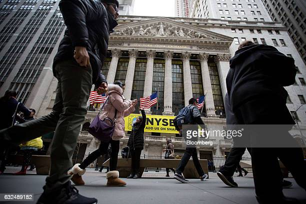 Pedestrians pass in front of the New York Stock Exchange in New York US on Monday Jan 23 2017 US stocks fell as losses in energy and industrial...