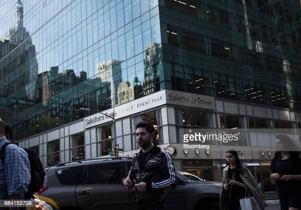 Pedestrians pass in front of the Salesforce Tower in New York US on Friday April 28 2017 Salesforcecom Inc is scheduled to release earning figures on...