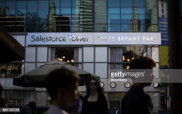 Pedestrians pass in front of the Salesforce Tower stands in New York US on Friday April 28 2017 Salesforcecom Inc is scheduled to release earning...