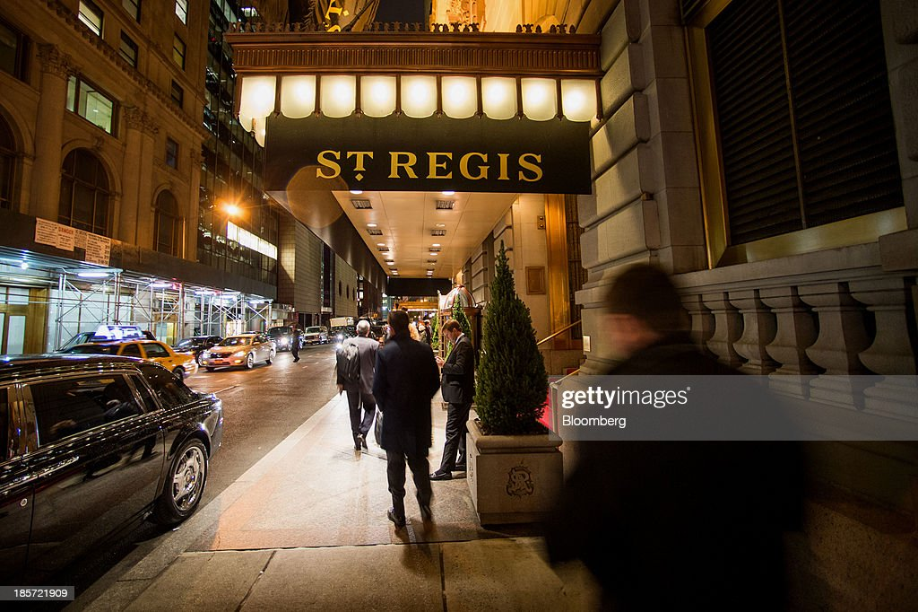 Pedestrians pass in front of The St. Regis Hotel, a Starwood Hotels & Resorts Worldwide Inc. property, in New York, U.S., on Wednesday, Oct. 23, 2013. Starwood Hotels & Resorts Worldwide Inc., the owner of the Sheraton and W brands, rose the most in three months after it reported third-quarter earnings that beat estimates and forecast an increase in revenue growth for 2014. Photographer: Craig Warga/Bloomberg via Getty Images