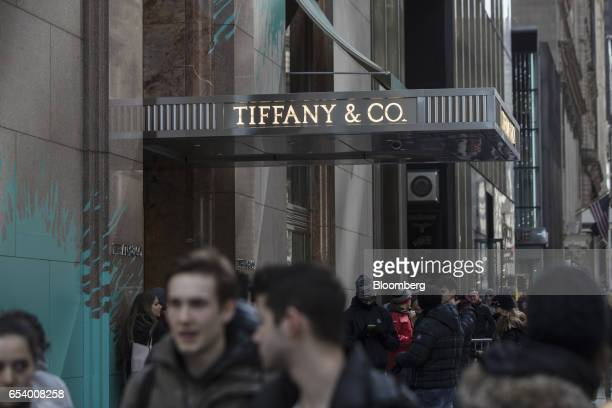 Pedestrians pass in front of the Tiffany Co flagship store on Fifth Avenue in New York US on Monday March 13 2017 Tiffany Co is scheduled to release...