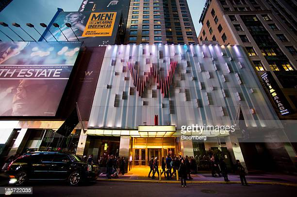 Pedestrians pass in front of the W Hotel New York Times Square a Starwood Hotels Resorts Worldwide Inc property in New York US on Wednesday Oct 23...