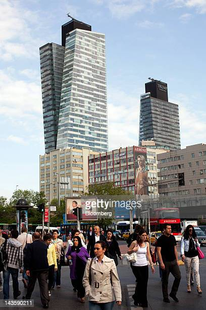 Pedestrians pass in front of Trump Towers and Plaza a residential and commercial development in the Mecidiyekoy district of Istanbul Turkey on Friday...