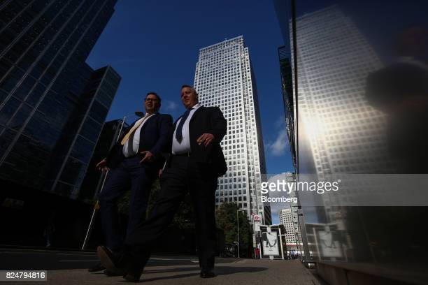 Pedestrians pass One Canada Square which houses the European Banking Authority in the Canary Wharf financial business and shopping district in London...