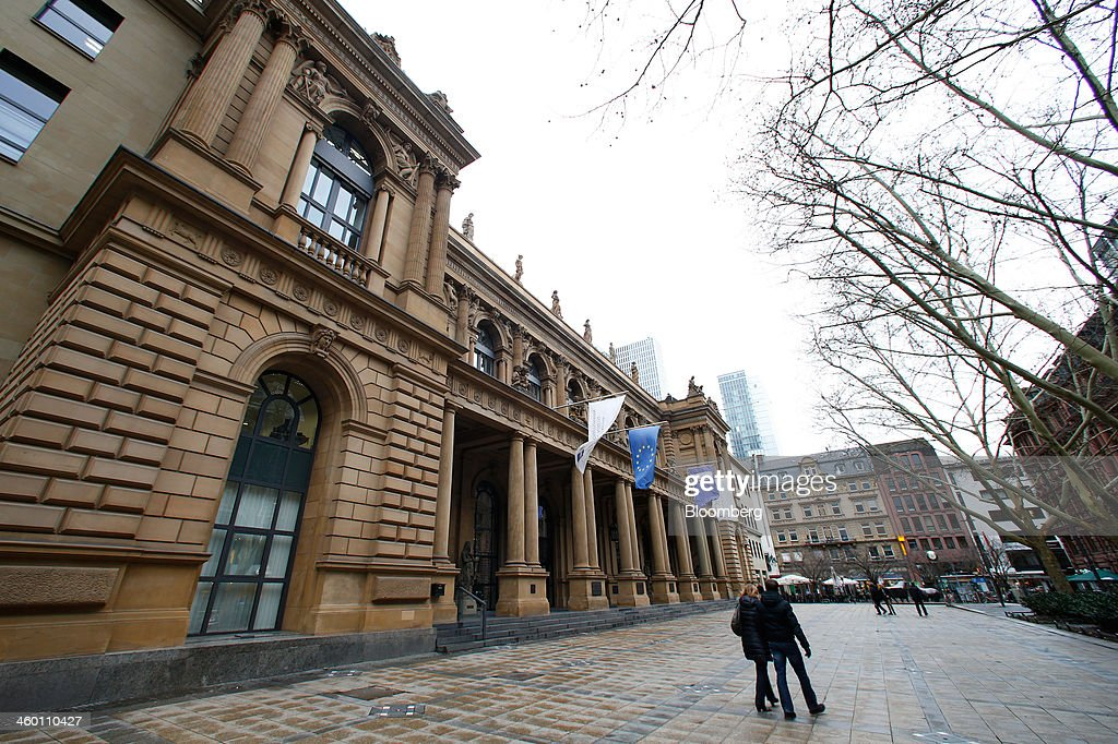 Pedestrians pass outside the Frankfurt Stock Exchange in Frankfurt, Germany, on Thursday, Jan. 2, 2014. Most German stocks fell on the first day of trading in 2014, following an annual gain for the benchmark DAX Index, as data showed manufacturing in Europe's largest economy expanded for a sixth month. Photographer: Ralph Orlowski/Bloomberg via Getty Images