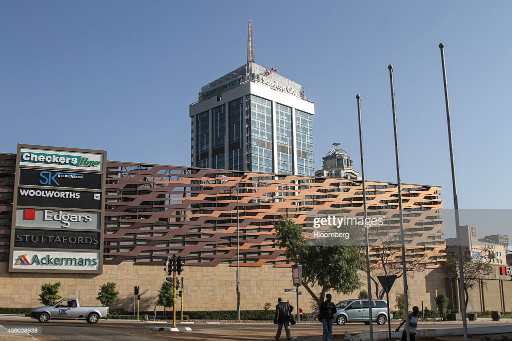 Pedestrians pass Sandton City shopping mall in Sandton South Africa on Tuesday Sept 23 2014 Sandton once a single 20story tower and a shopping mall...