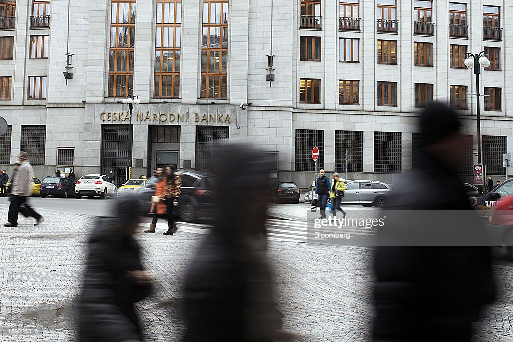 Pedestrians pass the Czech central bank, center, in Prague, Czech Republic, on Wednesday, Jan. 9, 2013. The Czech economy is showing weak domestic demand as households and businesses cut spending due to government austerity programs and the euro area's debt crisis. Photographer: Bartek Sadowski/Bloomberg via Getty Images