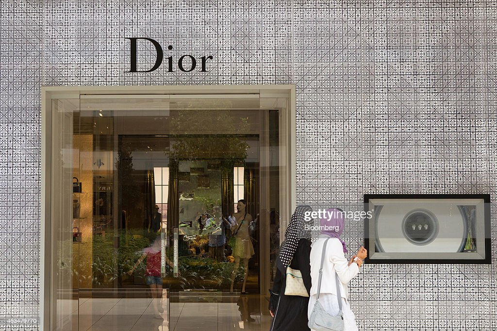 Pedestrians pass the entrance and display window of a Dior luxury fashion store, operated by Christian Dior SA, in the Zorlu shopping mall in Istanbul, Turkey, on Sunday, Aug. 10, 2014. Investors said they will need to assess the next government's commitment to financial stability should Turkish Prime Minister Recep Tayyip Erdogan assume the presidency this month. Photographer: Kerem Uzel/Bloomberg via Getty Images