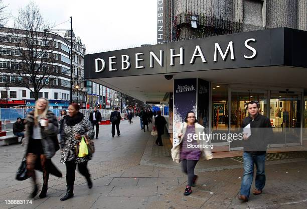 Pedestrians pass the entrance to a Debenhams store on Oxford Street in London UK on Tuesday Jan 10 2012 Debenhams Plc the UK's secondlargest...
