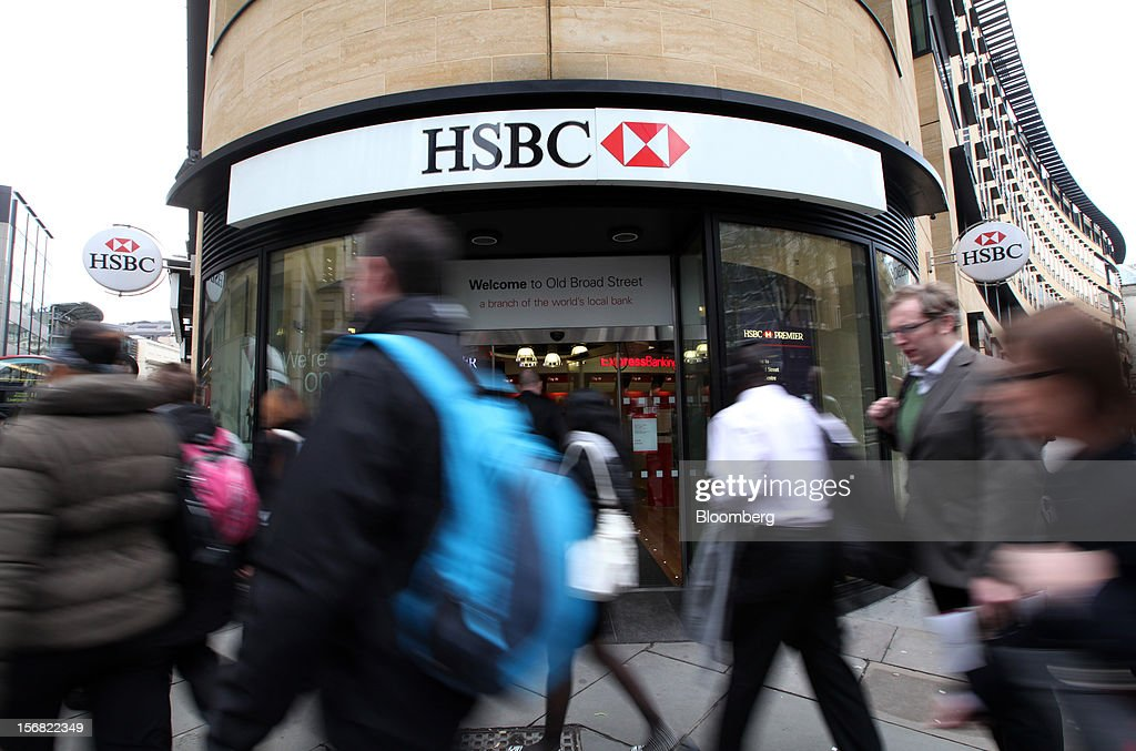 Pedestrians pass the entrance to a HSBC Holdings Plc bank branch in London, U.K., on Thursday, Nov. 22, 2012. Shares of HSBC have climbed 26 percent this year in London trading, and 30 percent in Hong Kong, as Chief Executive Officer Stuart Gulliver pared costs and sold assets to revive profit and focus on emerging economies in which the bank has a greater market share. Photographer: Chris Ratcliffe/Bloomberg via Getty Images