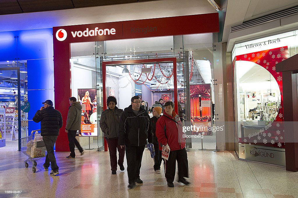 Pedestrians pass the entrance to a Vodafone Iceland Fjarskipti hf store inside the Kringlan shopping center in Reykjavik, Iceland, on Wednesday, Jan. 2, 2013. Creditors of Iceland's three biggest failed banks are fighting for a waiver to krona controls imposed in 2008 amid risks pay-outs will be delayed beyond 2015. Photographer: Arnaldur Halldorsson/Bloomberg via Getty Images