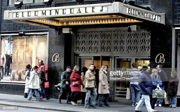 Pedestrians pass the entrance to Bloomingdale's February 28 2005 in New York City Federated Department Stores Inc is buying rival May Department...