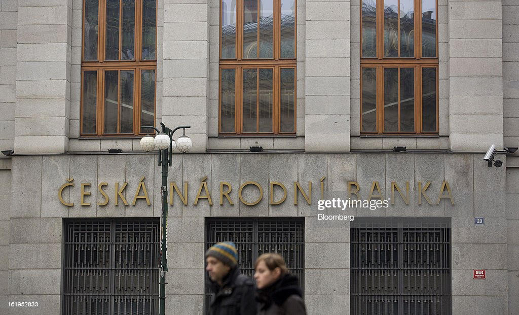 Pedestrians pass the entrance to the Czech central bank in Prague, Czech Republic, on Sunday, Feb. 17, 2013. Worsened outlook for Czech economy is in line with the government's expectations and lower-than-planned tax revenue is 'manageable' under 2013 budget, Prime Minister Petr Necas said on Czech public television. Photographer: Martin Divisek/Bloomberg via Getty Images
