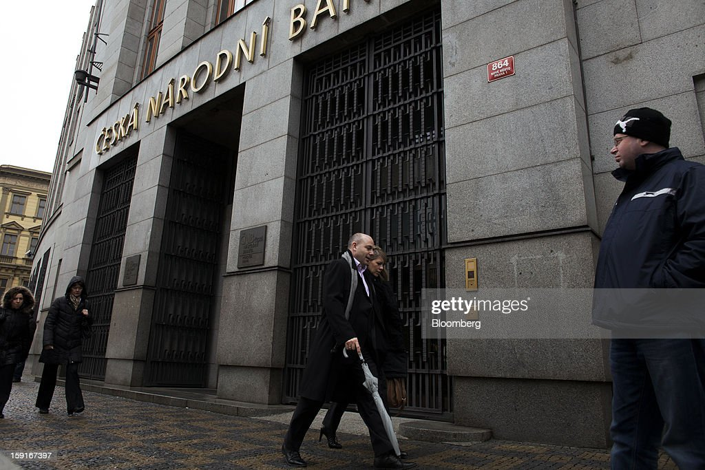 Pedestrians pass the entrance to the Czech central bank in the financial district of Prague, Czech Republic, on Tuesday, Jan. 8, 2013. The Czech economy is showing weak domestic demand as households and businesses cut spending due to government austerity programs and the euro area's debt crisis. Photographer: Bartek Sadowski/Bloomberg via Getty Images